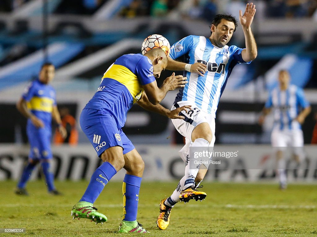 Daniel Diaz of Boca Juniors fights for the ball with <a gi-track='captionPersonalityLinkClicked' href=/galleries/search?phrase=Diego+Milito&family=editorial&specificpeople=689963 ng-click='$event.stopPropagation()'>Diego Milito</a> of Racing Club during a match between Racing and Boca Juniors as part of Copa Bridgestone Libertadores 2016 at Presidente Peron Stadium on April 13, 2016 in Avellaneda, Argentina.