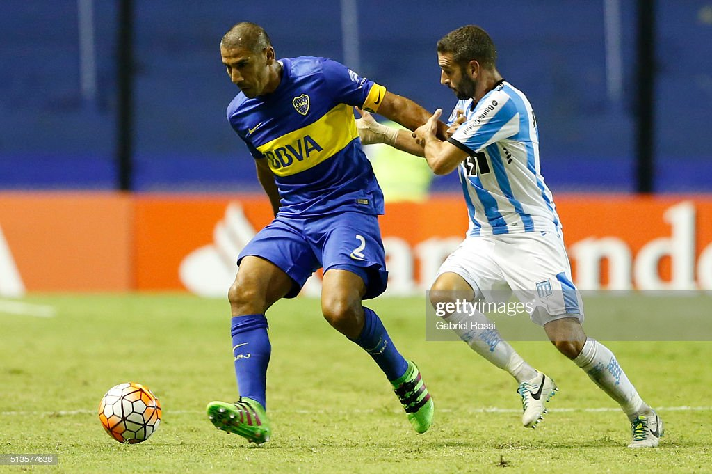 Daniel Diaz of Boca Juniors fights for the ball with <a gi-track='captionPersonalityLinkClicked' href=/galleries/search?phrase=Lisandro+Lopez&family=editorial&specificpeople=801562 ng-click='$event.stopPropagation()'>Lisandro Lopez</a> of Racing Club during a group stage match between Boca Juniors and Racing Club as part of Copa Bridgestone Libertadores 2016 at Alberto J. Armando Stadium on March 03, 2016 in Buenos Aires, Argentina.