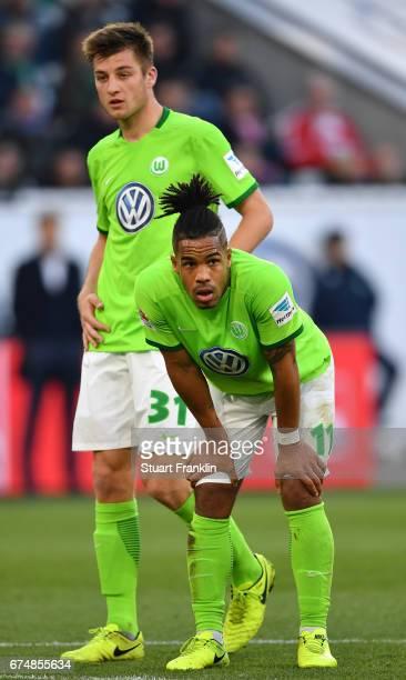 Daniel Didavi and Robin Knoche of Wolfsburg look dejected during the Bundesliga match between VfL Wolfsburg and Bayern Muenchen at Volkswagen Arena...