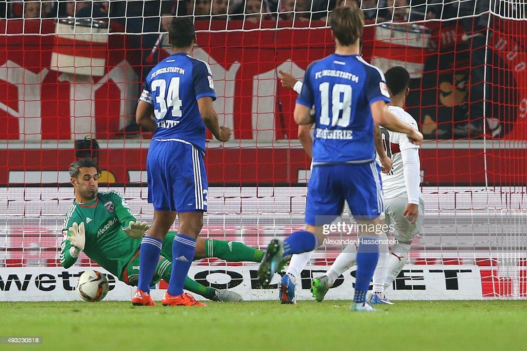 Daniel Didavi of Stuttgart bscores the opening goal against Ramazan Oezcan keeper of Ingolstadt during the Bundesliga match between VfB Stuttgart and...