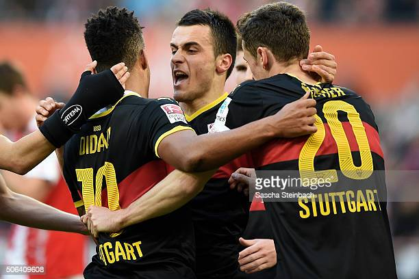 Daniel Didavi of Stuttgart celebrates with team mates Filip Kostic and Christian Gentner after scoring his team's first goal during the Bundesliga...