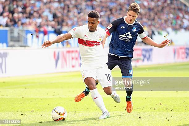 Daniel Didavi of Stuttgart is challenged by Pirmin Schwegler of Hoffenheim during the Bundesliga match between 1899 Hoffenheim and VfB Stuttgart at...
