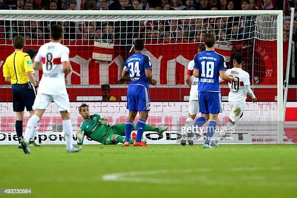 Daniel Didavi of Stuttgart scores the opening goal against Ramazan Oezcan keeper of Ingolstadt during the Bundesliga match between VfB Stuttgart and...