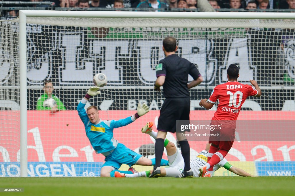 <a gi-track='captionPersonalityLinkClicked' href=/galleries/search?phrase=Daniel+Didavi&family=editorial&specificpeople=4409864 ng-click='$event.stopPropagation()'>Daniel Didavi</a> of VfB Stuttgart scores his team's opening goal during the Bundesliga match between Borussia Moenchengladbach and VfB Stuttgart at Borussia-Park on April 12, 2014 in Moenchengladbach, Germany.