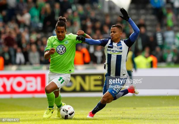 Daniel Didavi of VfL Wolfsburg is challenged by Allan of Hertha BSC during the Bundesliga match between Hertha BSC and VfL Wolfsburg at...