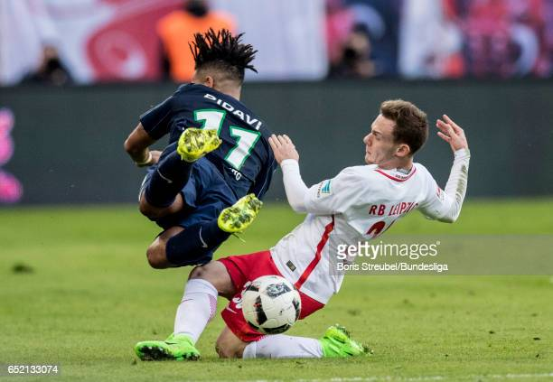 Daniel Didavi of VfL Wolfsburg is tackled by Federico Palacios of RB Leipzig during the Bundesliga match between RB Leipzig and VfL Wolfsburg at Red...