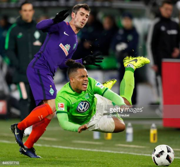 Daniel Didavi of VfL Wolfsburg is tackled by Fin Bartels of SV Werder Bremen during the Bundesliga match between VfL Wolfsburg and Werder Bremen at...