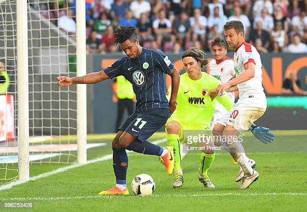 Daniel Didavi of VfL Wolfsburg tries to score against Marwin Hitz and Daniel Baier of FC Augsburg challenges during the Bundesliga match between FC...
