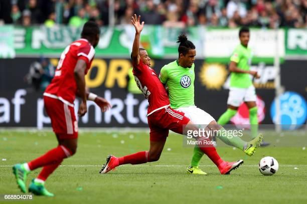 Daniel Didavi of Wolfsburg and Marcel Tisserand of Ingolstadt battle for the ball during the Bundesliga match between VfL Wolfsburg and FC Ingolstadt...