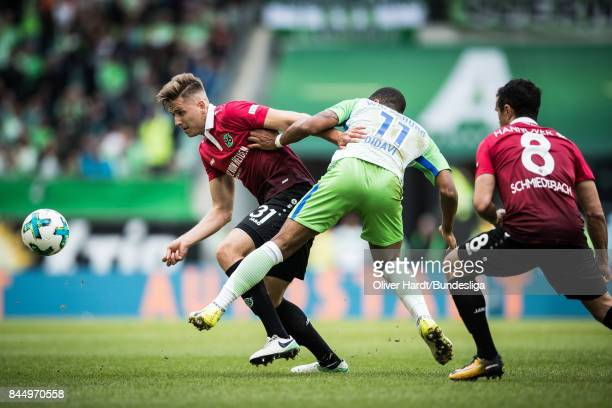 Daniel Didavi of Wolfsburg and Waldemar Anton of Hannover compete for the ball during the Bundesliga match between VfL Wolfsburg and Hannover 96 at...