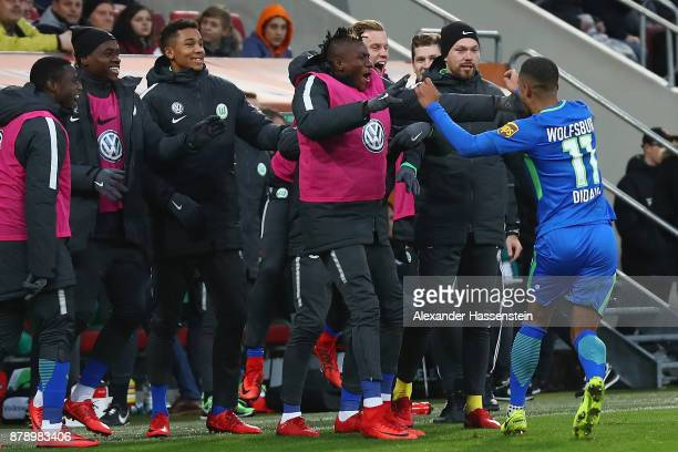 Daniel Didavi of Wolfsburg celebrates with his team mates after he scored to make it 10 during the Bundesliga match between FC Augsburg and VfL...