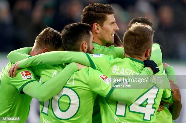 Daniel Didavi of Wolfsburg celebrates with team mates after scoring his teams second goal during the Bundesliga match between VfL Wolfsburg and TSG...