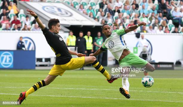 Daniel Didavi of Wolfsburg is attacked by Marc Bartra of Dortmund compete during the Bundesliga match between VfL Wolfsburg and Borussia Dortmund at...