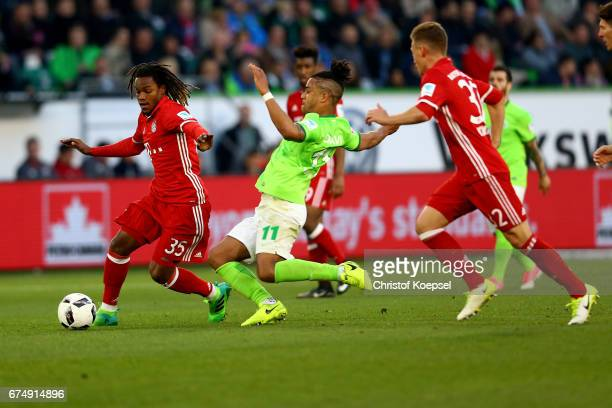 Daniel Difavi of Wolfsburg challenges Renato Sanches of Bayern Muenchen during the Bundesliga match between VfL Wolfsburg and Bayern Muenchen at...