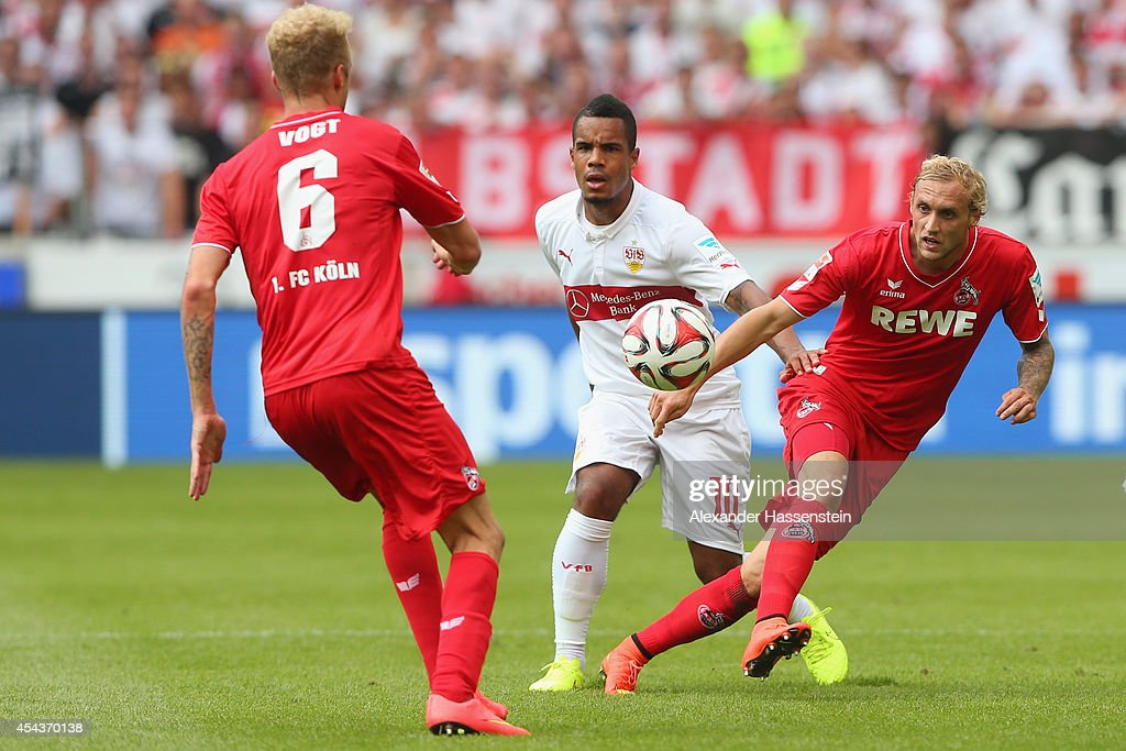 Daniel Divadi (C) of Stuttgart battles for the ball with <a gi-track='captionPersonalityLinkClicked' href=/galleries/search?phrase=Marcel+Risse&family=editorial&specificpeople=4331527 ng-click='$event.stopPropagation()'>Marcel Risse</a> (R) of Koeln and his team mate Kevin Vogt during the Bundesliga match between VfB Stuttgart and 1. FC Koeln at Mercedes-Benz Arena on August 30, 2014 in Stuttgart, Germany.