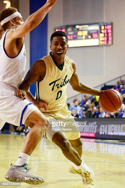 Daniel Dixon of the William Mary Tribe drives against Darian Bryant of the Delaware Fightin Blue Hens during the second half at the Bob Carpenter...