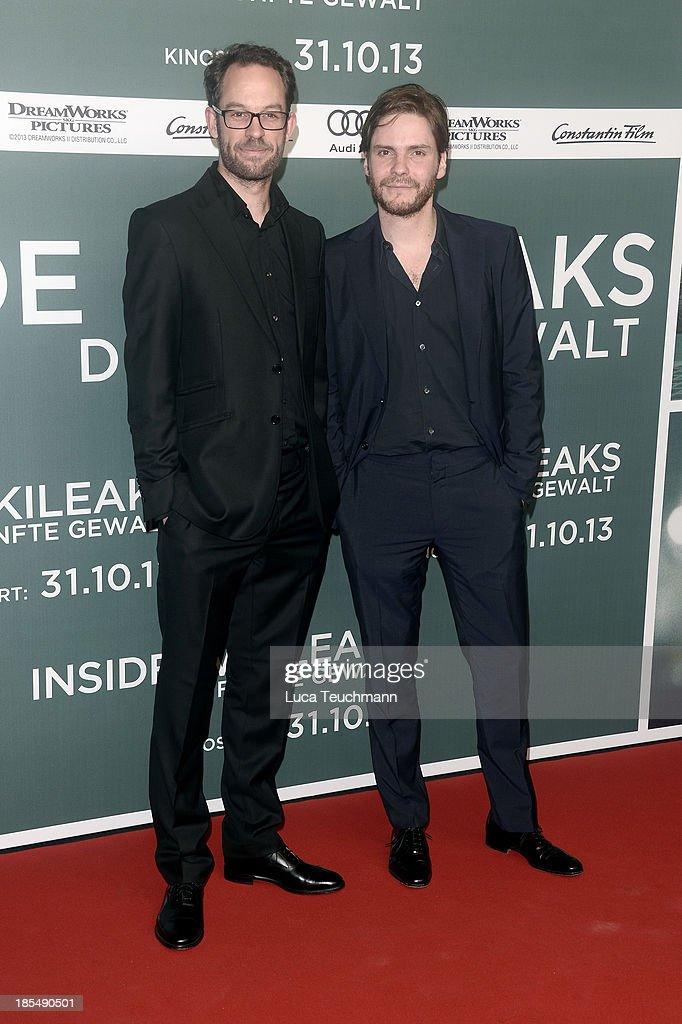 Daniel DomscheitBerg and Daniel Bruehl attend the 'Inside Wikileaks' Germany Premiere at Kulturbrauerei on October 21 2013 in Berlin Germany