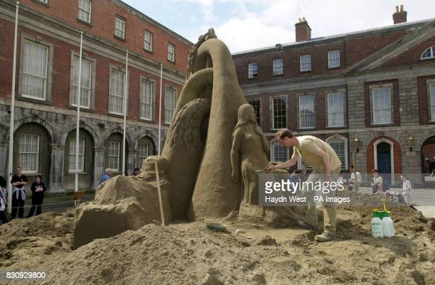 Daniel Doyle working on one of the largest sand sculptures ever made in Ireland at Dublin Castle the Republic of Ireland Mr Doyle is a member of...