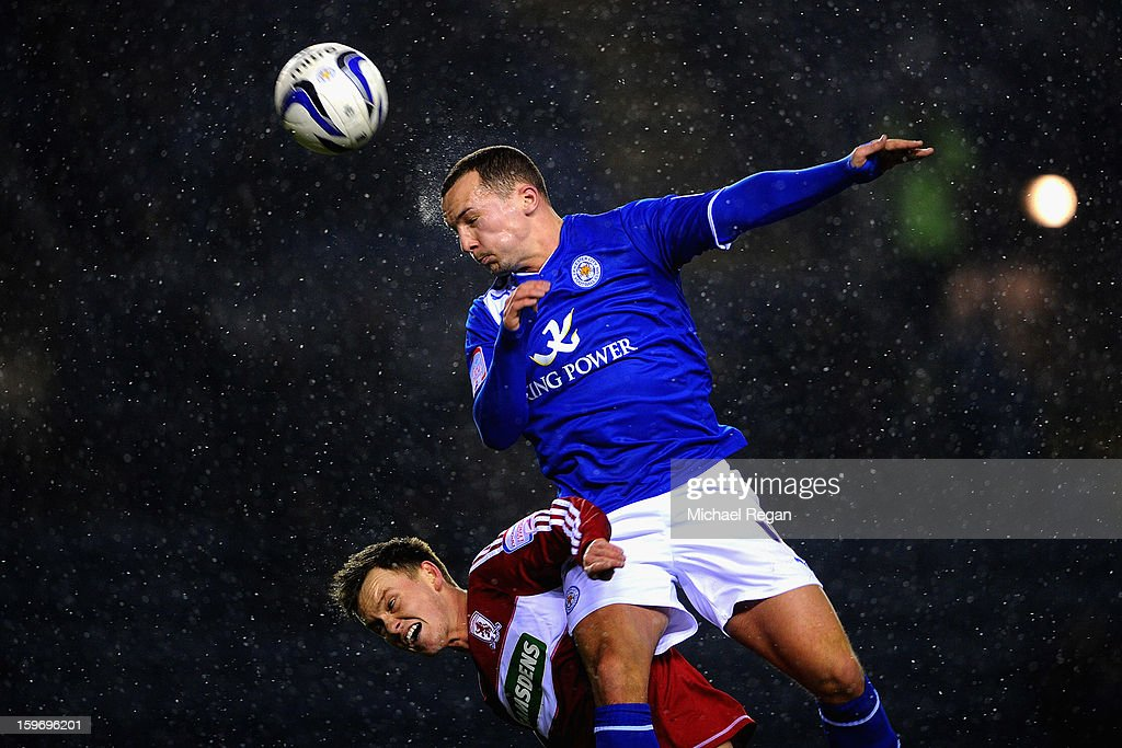 Daniel Drinkwater of Leicester out jumps <a gi-track='captionPersonalityLinkClicked' href=/galleries/search?phrase=Josh+McEachran&family=editorial&specificpeople=6871629 ng-click='$event.stopPropagation()'>Josh McEachran</a> of Boro during the Npower Championship between Leicester City and Middlesbrough at The King Power Stadium on January 18, 2013 in Leicester, England.