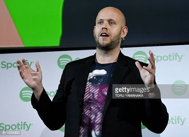 Daniel Ek CEO of Swedish music streaming service Spotify gestures as he makes a speech at a press conference in Tokyo on September 29 2016 Spotify...