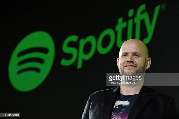 Daniel Ek CEO of Swedish music streaming service Spotify poses for photographers at a press conference in Tokyo on September 29 2016 Spotify kicked...
