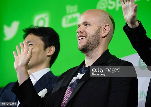 Daniel Ek chief executive officer and cofounder of Spotify AB right and Ochre Tamaki incoming president of Spotify Japan KK left wave as they stand...