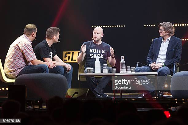 Daniel Ek chief executive officer and cofounder of Spotify AB second right speaks during a panel session at the Slush startups event in Helsinki...