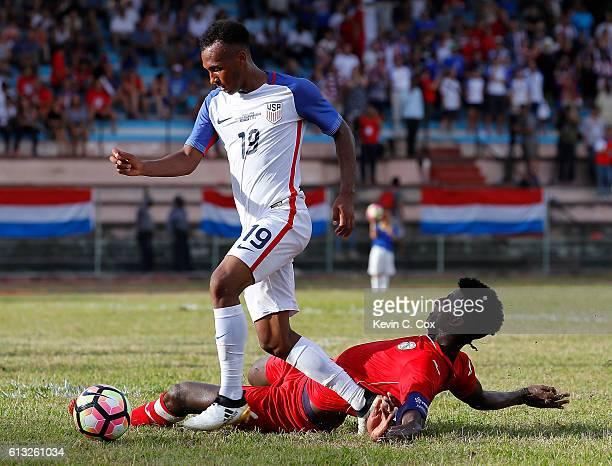 Daniel Ernesto Luis Saez of Cuba attempts to tackle Julian Green of the United States at Estadio Pedro Marrero on October 7 2016 in Havana Cuba