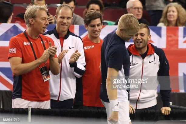 Daniel Evans and Kyle Edmund celebrate Great Britain's victory after Denis Shapovalov of Canada accidentelly hit the head umpire Arnaud Gabas in the...