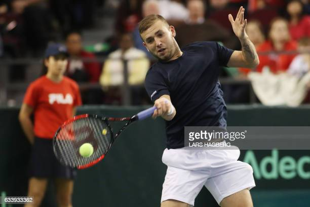 Daniel Evans of Great Britain a return against Vasek Pospisil of Canada during the third set the third day of Davis Cup first round between Canada...