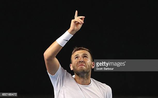 Daniel Evans of Great Britain celebrates match point and winning his third round match against Bernard Tomic of Australia on day five of the 2017...