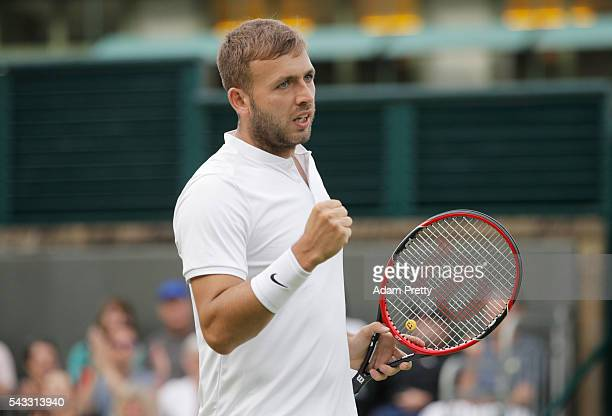 Daniel Evans of Great Britain celebrates victory following the Men's Singles first round match against JanLennard Struff on day one of the Wimbledon...