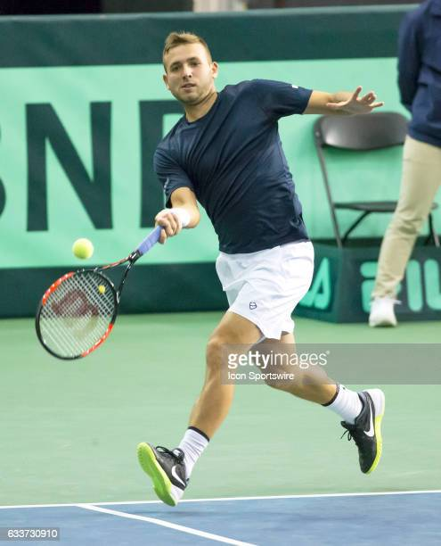 Daniel Evans of Great Britain chases down a shot by Denis Shapovalov of Canada early in the first set of their singles match in the BNP Paribas Davis...