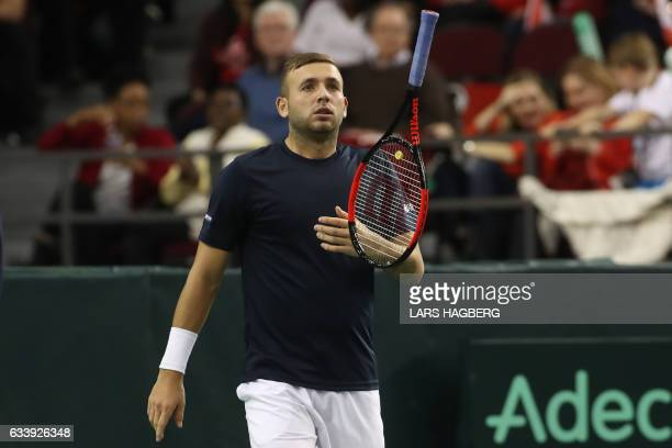 Daniel Evans of Great Britain flips his racket after losing a point against Vasek Pospisil of Canada during the third set on the third day of Davis...