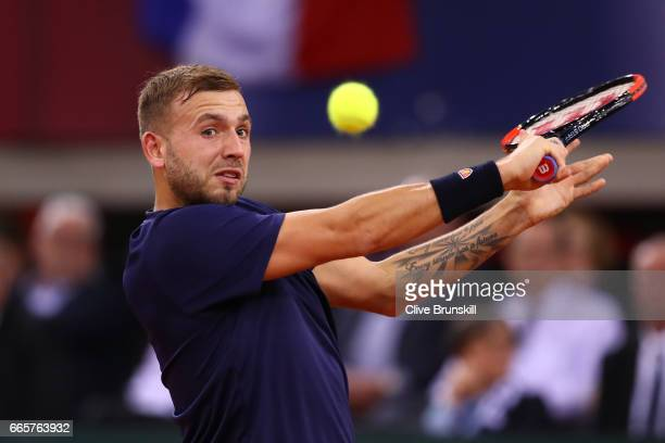 Daniel Evans of Great Britain hits a backhand during the singles match against Jeremy Chardy of France on day one of the Davis Cup World Group...