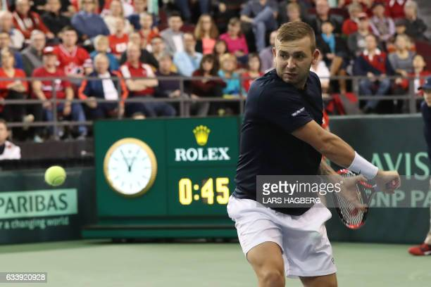 Daniel Evans of Great Britain hits a ball in the first set against Vasek Pospisil of Canada the third day of Davis Cup first round between Canada and...