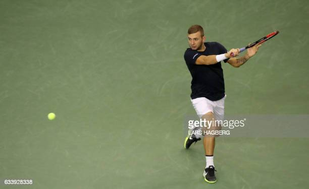 Daniel Evans of Great Britain hits a return in the fourth set against Vasek Pospisil of Canada the third day of Davis Cup first round between Canada...
