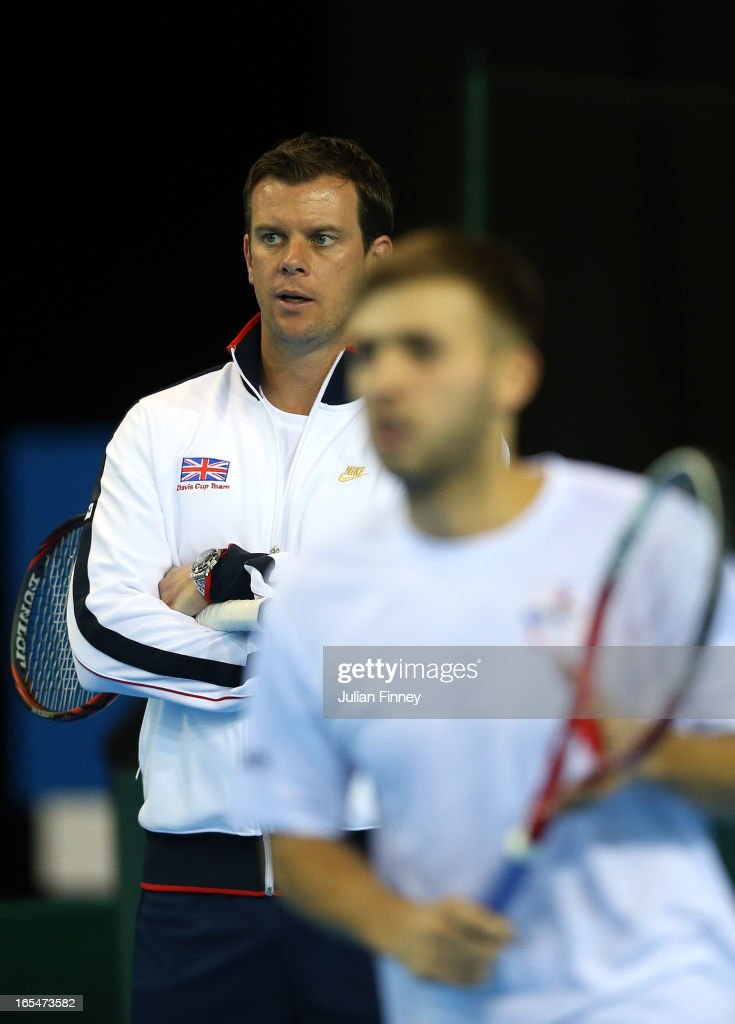 Daniel Evans of Great Britain in a practice session as Captain <a gi-track='captionPersonalityLinkClicked' href=/galleries/search?phrase=Leon+Smith+-+Tennis+Coach&family=editorial&specificpeople=12698515 ng-click='$event.stopPropagation()'>Leon Smith</a> watches on during previews for the Davis Cup match between Great Britain and Russia at the Ricoh Arena on April 4, 2013 in Coventry, England.