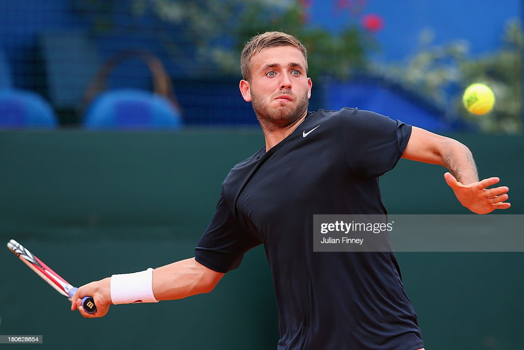 Daniel Evans of Great Britain in action against Mate Pavic of Croatia during day three of the Davis Cup World Group play-off tie between Croatia and Great Britain at Stadion Stella Maris on September 15, 2013 in Umag, Croatia.