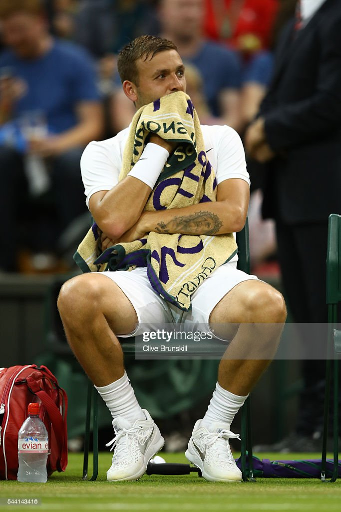 Daniel Evans of Great Britain looks on during the Men's Singles third round match against Roger Federer of Switzerland on day five of the Wimbledon Lawn Tennis Championships at the All England Lawn Tennis and Croquet Club on July 1, 2016 in London, England.