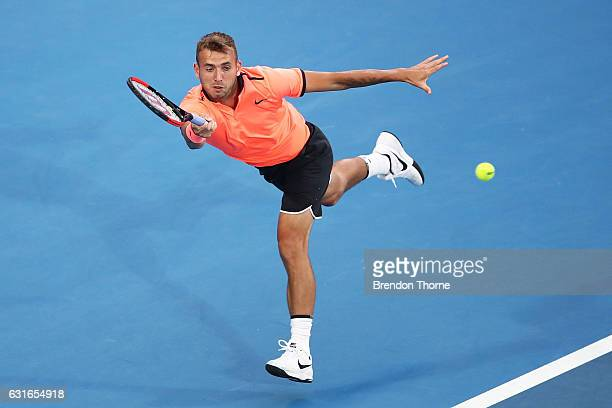Daniel Evans of Great Britain plays a forehand in the men's final match against Gilles Muller of Luxembourg during the 2017 Sydney International at...