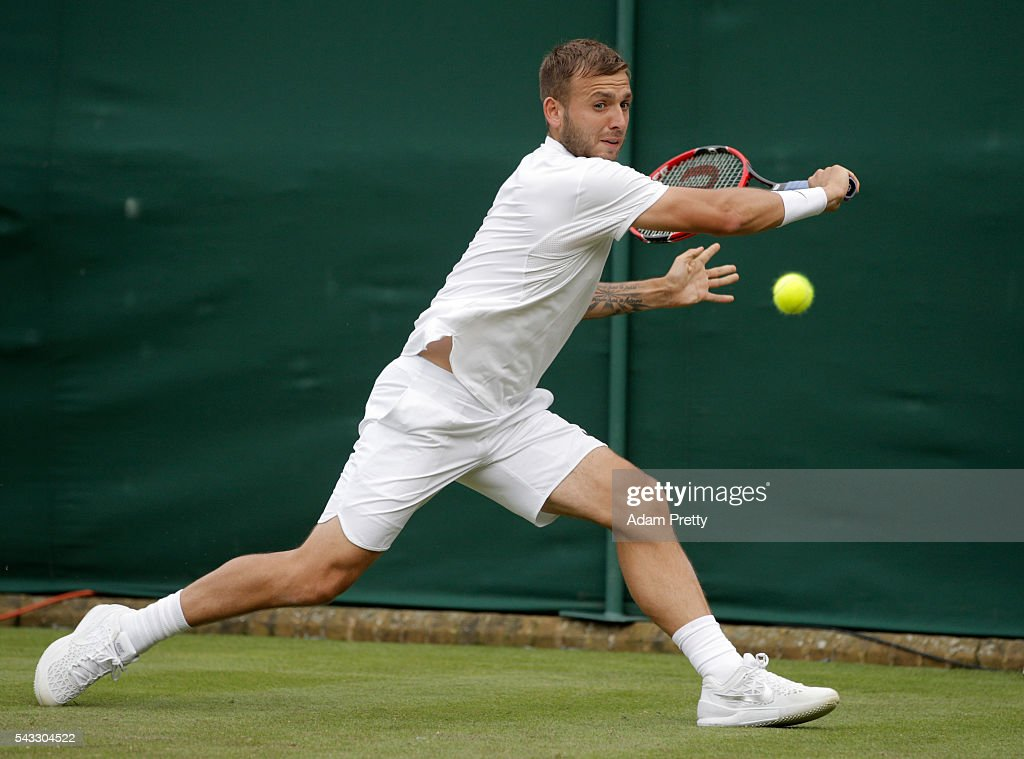 Daniel Evans of Great Britain plays a forehand shot during the Men's Singles first round match against Jan-Lennard Struff on day one of the Wimbledon Lawn Tennis Championships at the All England Lawn Tennis and Croquet Club on June 27th, 2016 in London, England.