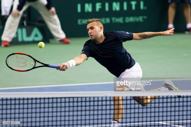 Daniel Evans of Great Britain reaches to volley the ball back at Denis Shapovalov of Canada in the BNP Paribas Davis Cup Tennis Canada v Great...