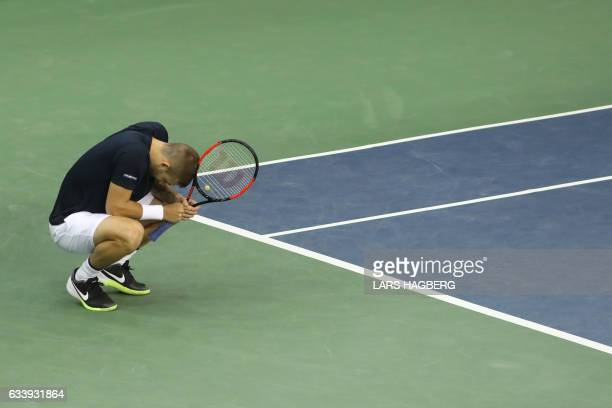 Daniel Evans of Great Britain reacts after losing a point Vasek Pospisil of Canada during the fourth set on the third day of Davis Cup first round...