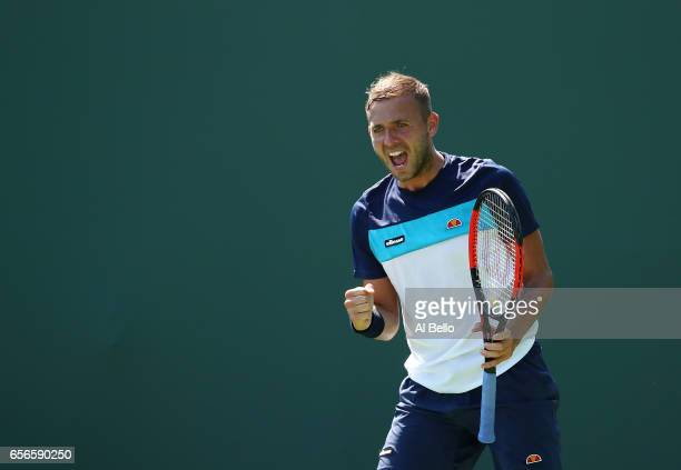 Daniel Evans of Great Britain reacts during his match against Ernesto Escobedo during day 3 of the Miami Open at Crandon Park Tennis Center on March...