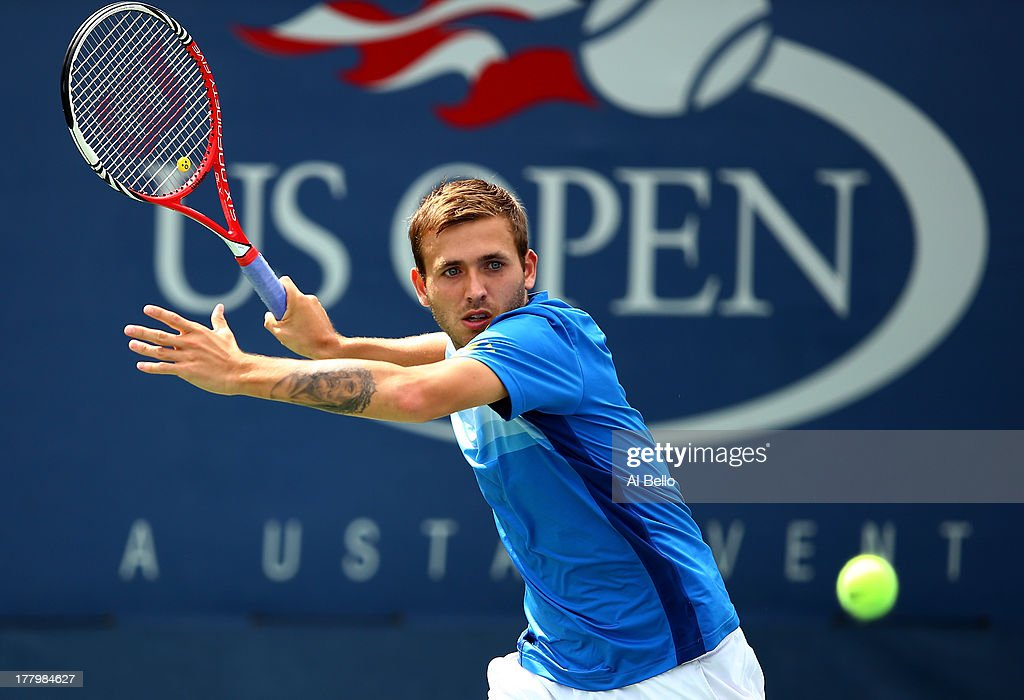Daniel Evans of Great Britain returns a shot against Kei Nishikori of Japan during their first round men's singles match on Day One of the 2013 US Open at USTA Billie Jean King National Tennis Center on August 26, 2013 in the Flushing neighborhood of the Queens borough of New York City.