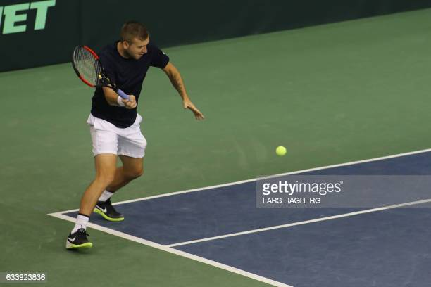 Daniel Evans of Great Britain returns a shot in the second set against Vasek Pospisil of Canada the third day of Davis Cup first round between Canada...