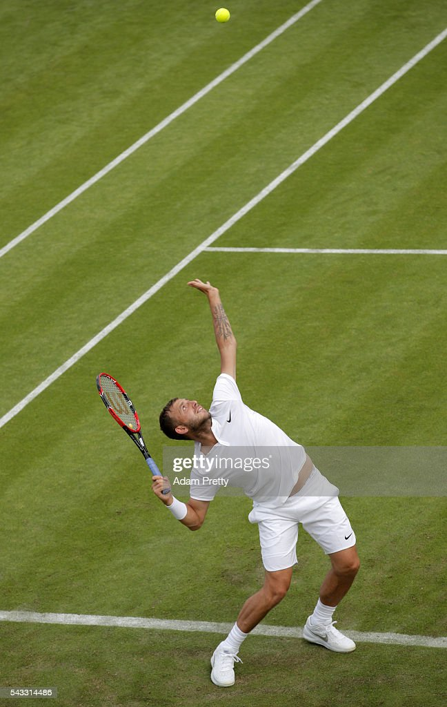 Daniel Evans of Great Britain serves during the Men's Singles first round match against Jan-Lennard Struff on day one of the Wimbledon Lawn Tennis Championships at the All England Lawn Tennis and Croquet Club on June 27th, 2016 in London, England.