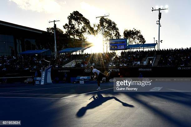 Daniel Evans of Great Britain serves in his second round match against Marin Cilic of Croatia on day three of the 2017 Australian Open at Melbourne...