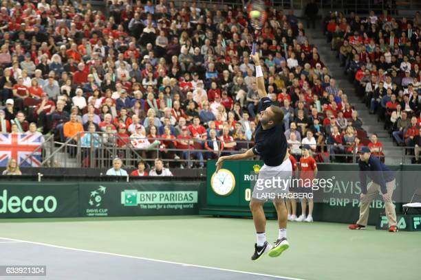 Daniel Evans of Great Britain serves in the first set against Vasek Pospisil of Canada the third day of Davis Cup first round between Canada and...